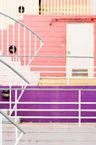 White metal railing and colorful wall Stock Photos