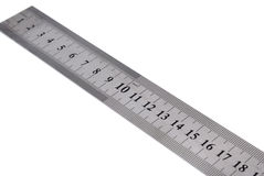 White metal ruler. On a white background Royalty Free Stock Photos