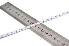 White metal ruler and measuring tape. On a white background Stock Photos