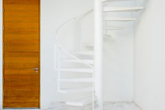 White metal spiral staircase Stock Images