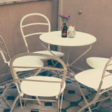 White metal table and chairs Royalty Free Stock Images