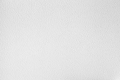 White metal wall with plaster. Closeup background Stock Photos