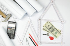 White meter tool forming a house and tools on white paper backgr Stock Photography