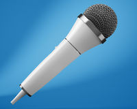 White microphone on blue background Royalty Free Stock Photo