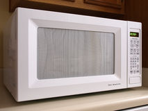White Microwave Oven Front Stock Photo