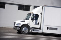 White mid power size semi truck with box trailer for city delive Stock Photography