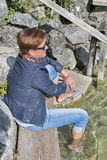 White middle aged woman in autumn clothes by the lake Stock Photo