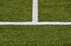 white middle line and sideline on a green turf Stock Photo