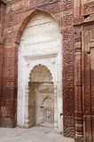 White mihrab in Qutub mosque in Delhi,India,Unesco heritage royalty free stock image