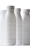 White Milk Bottles Stock Image