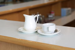 White milk jug and cup Stock Photography