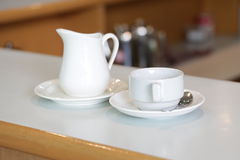 White milk jug and cup for Royalty Free Stock Photos