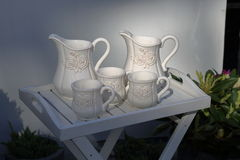 White milk jugs and cups Royalty Free Stock Images