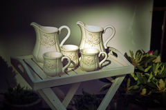White milk jugs and cups Stock Photography