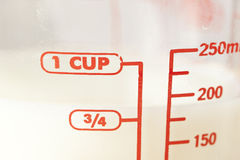 White milk in a measuring cup Royalty Free Stock Photography