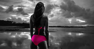 White millennial female looks out onto the stormy sunset on the beaches of St John Royalty Free Stock Photos