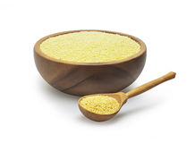 White millet in a wooden bowl Stock Images