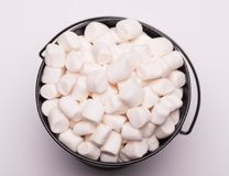 White mini marshmallows background close-up texture. Food background. Copy space. stock photos