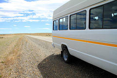 Minibus on Roadside. A white minibus parked on the side of the road in the rural wild area of Patagonia, South America Royalty Free Stock Photo