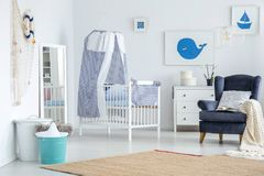 Mirror in the corner. White mirror placed in the corner of baby`s room with carpet and decorations Stock Photography