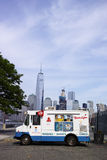 White Mister Softee ice cream truck in Jersey City with New York. Financial district in background - July 4, 2016, Sussex Street, Jersey City, NJ, USA Stock Photo