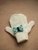 White mittens and blue bow Royalty Free Stock Image