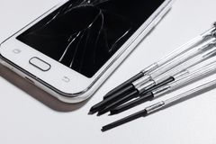 A white mobile phone is broken screen on white background.blank for copy space. isolated royalty free stock photos