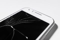 A white mobile phone is broken screen on white background.blank for copy space. Closeup royalty free stock images