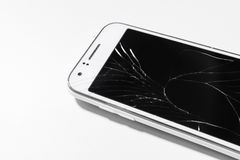 A white mobile phone is broken screen on white background.blank for copy space. Closeup royalty free stock photos