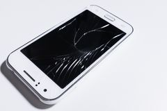 A white mobile phone is broken screen on white background.blank for copy space.  stock photos