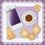 White Mobile phone with hot chocolate and Christmas gingerbread. Stock Photos