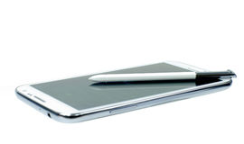 White mobile phone with stylus pen. Easy to work with this device with pen and screens Royalty Free Stock Photo