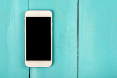 White Mobile Phone With On Wood Table Stock Photos