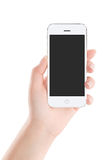 White mobile smart phone with blank screen in female hand Royalty Free Stock Photo