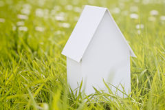 White Model House on Green Grass Royalty Free Stock Images