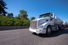 Semi truck with two tank trailers carry fuel on the road Stock Image