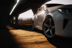 White modern car on the road at sunrise Royalty Free Stock Photo