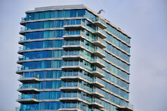 White modern commercial building, with many stories. And glass windows Royalty Free Stock Image
