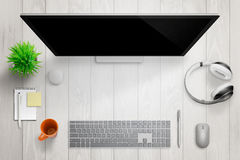 White modern desk with computer display. Free space for text Royalty Free Stock Photography