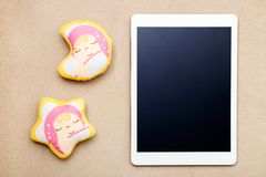 White modern digital tablet and baby toy on fabric texture stock image