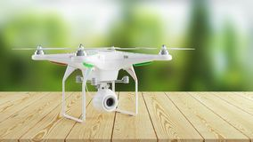 White modern drone on wooden table on background of nature Stock Photos