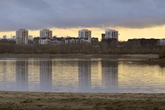Houses on the autumn bank of the Ob River in Novosibirsk stock image
