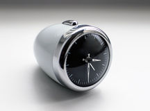White modern oval stylish design alarm clock Royalty Free Stock Photography