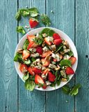 Fresh strawberry salad with spinach leaves, blue cheese and walnuts. On white modern plate there is some fresh strawberry salad with spinach leaves, blue cheese Royalty Free Stock Photo