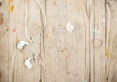 White modern portable audio earphones Stock Photos