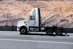 White modern semi truck reefer trailer on green summer highway Stock Photography