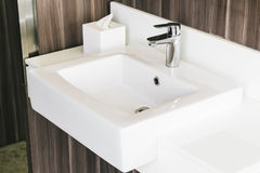 White modern sink and faucet in bathroom Royalty Free Stock Photography
