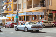 White modern sport-car on sunny street, Torrevieja, Valencia, Sp Royalty Free Stock Images