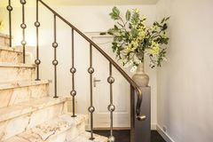 White modern stairs with ceramic vase and beautiful white flowers. Vintage style Stock Photos