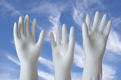 White Molded Plaster-of-Paris Hands Reaching Skyward Stock Photo